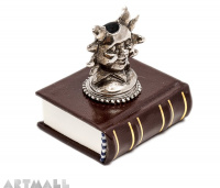 Metal decorated penstand on book reproduction. SUN